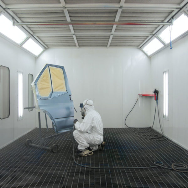Car door being sprayed in spray booth